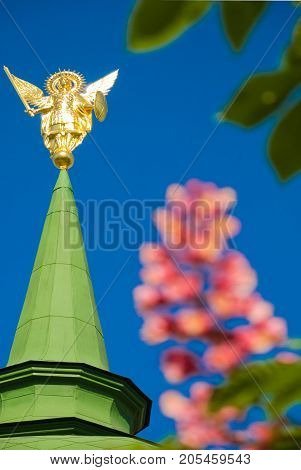 Archangel Michael on the steeple of the church. spring