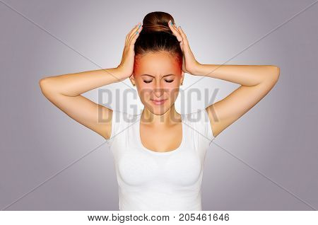 Health and pain. Young woman having strong tension headache. Closeup portrait of beautiful sick girl suffering from head migraine feeling pressure and stress.