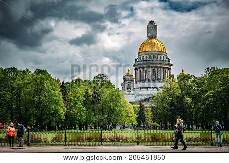 St. Petersburg, Russia - Circa June 2017: Saint Isaac Cathedral, View from St. Petersburg's waterfront to the temple and green trees