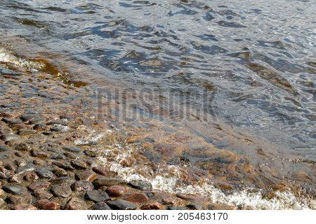 The water of the river Neva washes the stones of the base of Peter-Paul Fortress Fortress in Saint Petersburg, Russia.
