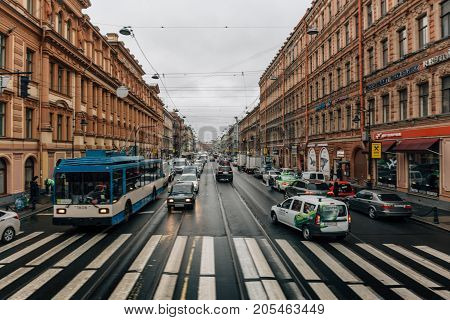 St. Petersburg, Russia - Circa June 2017: One of the old streets in the center of St. Petersburg with beautiful houses and lots of cars, perspective