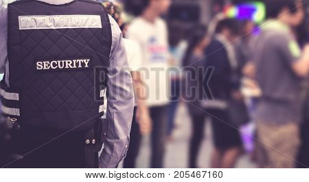 Security man standing indoors / soft focus picture / Vintage concept