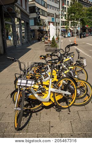 MunichGermany-September 242017: Bicycles for rent stand on a sidewalk in downtown Munich