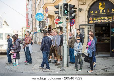 MunichGermany-September 242017: People on their way to the Oktoberfest wait to cross a street at a traffic light