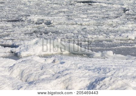 Natural Sea Ice Blocks Breaking Up Against The Shore And Ice During Freezing Winter Weather. In The