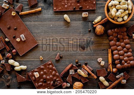 Mockup with chocolate on dark wooden background top view.