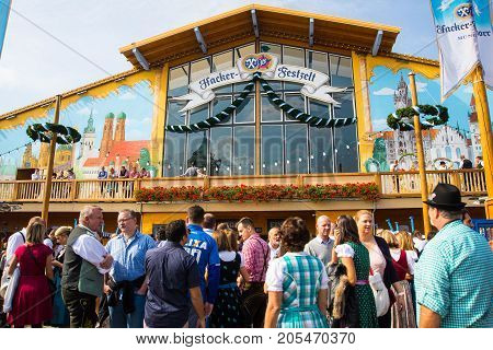 MunichGermany-September 242017: People stand outside one of the Beer tents at the Oktoberfest