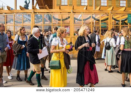 MunichGermany-September 242017: A group of people in typical bavarian costume stand ouside a beer tent