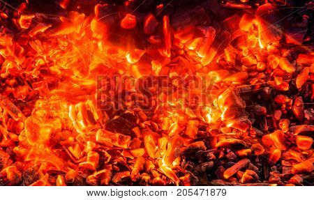 background from the burning charcoal . Photo of an abstract texture