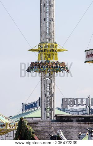 MunichGermany-September 242017: People rise in one of the carnival rides at the Oktoberfest