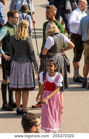 MunichGermany-September 242017: A girld in a typical bavarian dress smiles during the Oktoberfest