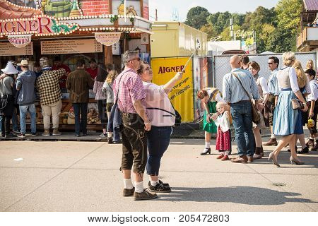 MunichGermany-September 242017: A couple takes selfie with their smartphone during the oktoberfest