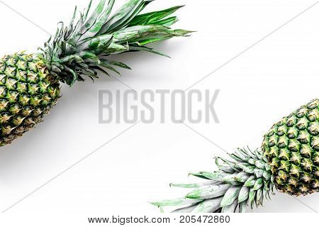Tropical fruits background. Pinneapple on white top view.