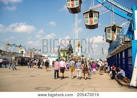 MunichGermany-September 242017:People walk under the ferris wheel at the Oktoberfest