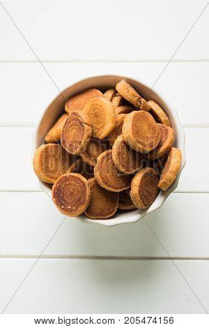 Stock Photo of Indian Fried Bhakarwadi Tea Time Snack also known as bakarwadi, bakarvadi, bakar vadi, bakar wadi or spring roll is a traditional spicy Maharashtran and Gujarat Snack