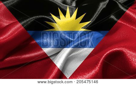 Realistic flag of Antigua and Barbuda on the wavy surface of fabric. This flag can be used in design