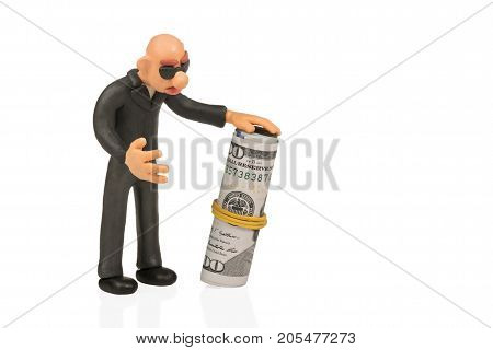 Bald plasticine man wearing glasses with roll of dollars isolated on white background