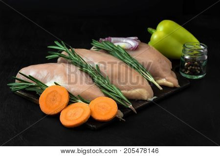 Chicken Breast With Rosemary And Carrots With Sweet Pepper And Onions.