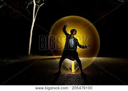 image of a girl in the dark with lights at the back