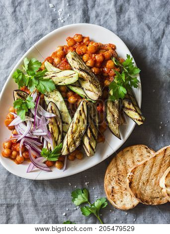 Braised chickpeas in tomato sauce grilled eggplant and zucchini grilled bread - a delicious appetizer or snack. Vegetarian food
