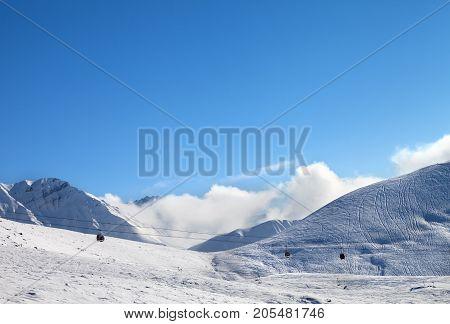 Gondola Lift And Off-piste Ski Slope