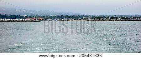 City and Ventura harbor as seen from ocean side San Buenaventura Southern California