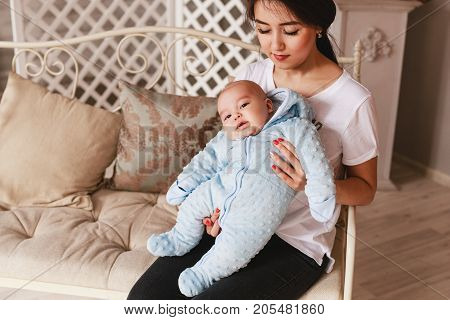 young asian mother and baby in the room.