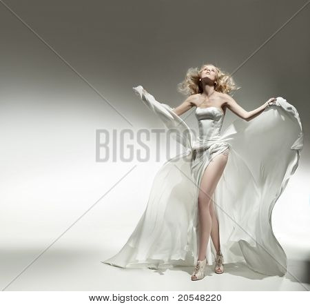 Romantic blonde beauty wearing white dress
