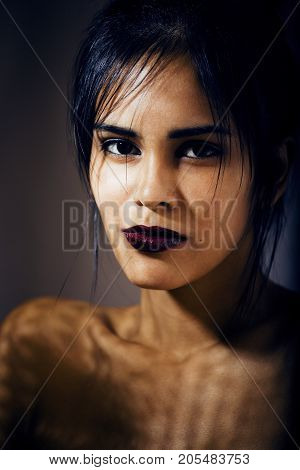 beauty latin young woman in depression, hopelessness look, fashion makeup modern close up