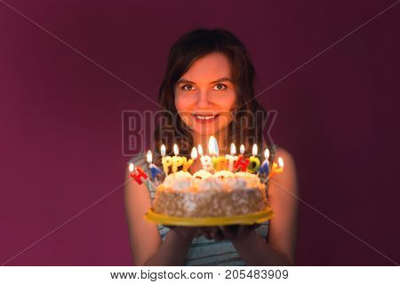 attractive teenage girl celebrating her birthday with cake.