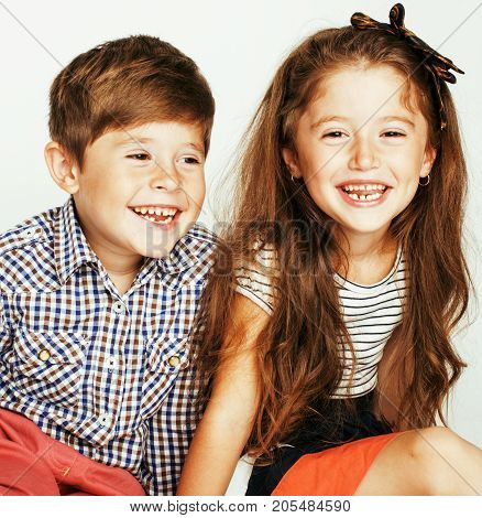 little cute boy and girl hugging playing on white background, happy family smiling twins, lifestyle people concept