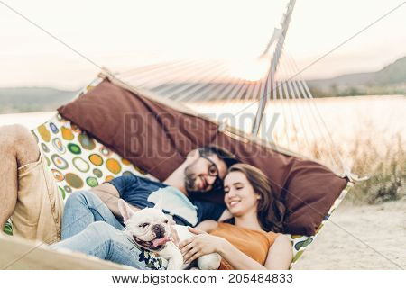 Hipster Couple On A Trip To The Beach, Young Freelancer Man Relaxing In A Hammock With His Woman, Ro