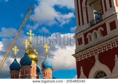 Christian church in the sun and a crane ,