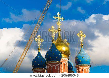 Christian church in the sun and a crane , russia