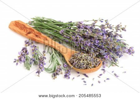 Bunch of lavender with spoon isolated on a white background.