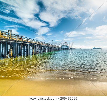 Wooden pier in Santa Barbara shoreline California