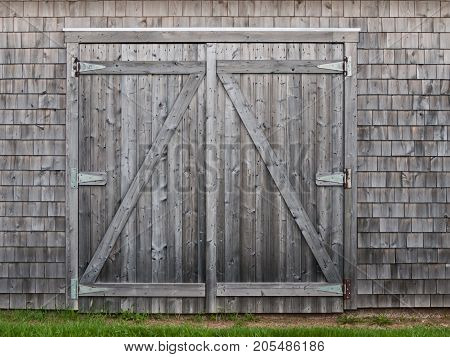 Old grey shades cedar barn doors in spring