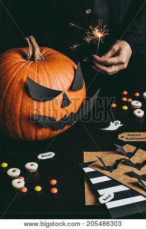 Halloween Preparation. Hands Making Halloween Cards Using Craft Paper