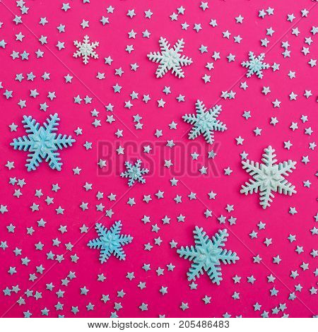 Snowflakes. Confection on pink background. Flat lay. Top view