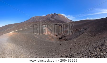 Panoramic view of Etna crater created by eruption in 2002 with main craters in the background Sicily Italy