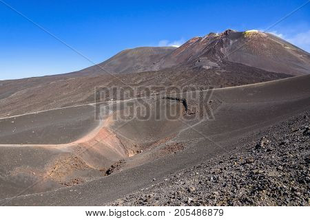 View of Etna crater created by eruption in 2002 with main craters in the background Sicily Italy