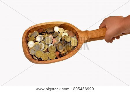 Isolated banknotes. In the spoon are coins. Salary.