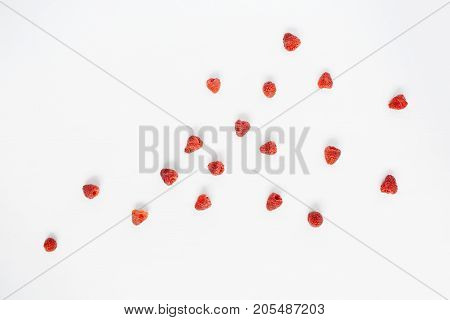 Raspberries on white background. Food blog or magazine concept texture.