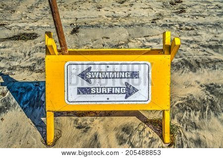 Swimming and Surfing wooden sign in Pacific Beach California