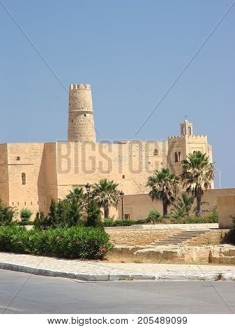 Stone fortress (ribat) with a tower and a mosque in the city of Monastir. Tunisia