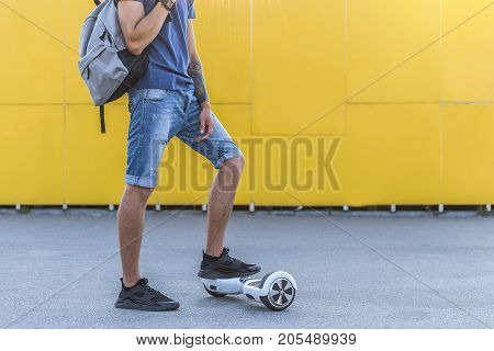 Close up male legs situating on giroscooter. Technology concept. Copy space