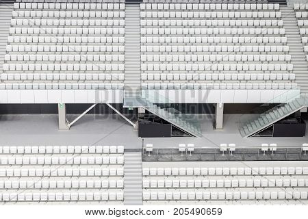 White seats in the large stadium as background