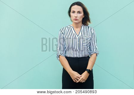Unhappy Business Woman Looking At Camera With Tired Face.