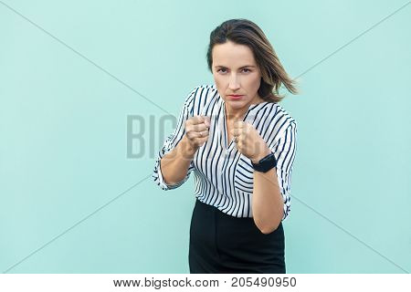 Boxing. Business Woman, Ready For Fight On Light Blue Background.