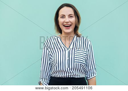Happiness Adult Success Businesswoman, Looking At Camera And Toothy Smile. Outdoor Shot In Summer.